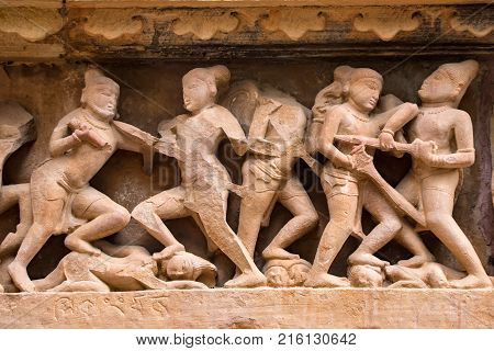 Famous military art bas relieves, Lakshmana Temple, Khajuraho, India. Battle scene with warriors, horsemen and elephat riders. Unesco World Heritage. Famous landmark in India. Killing