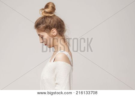 Side View Young Adult  Unwell Blonde Woman Looking Down.