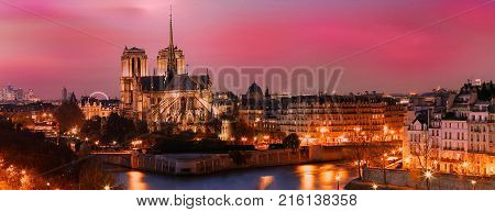 The picturesque grandiose sunset over Notre Dame cathedral Paris, France.
