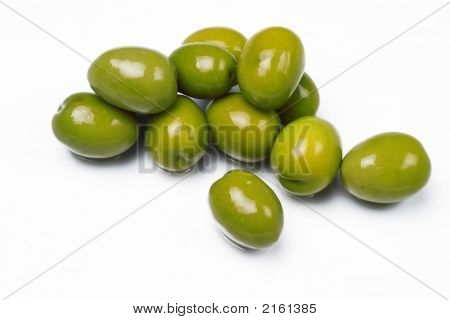 Green Olives Isolated On White Glass Table