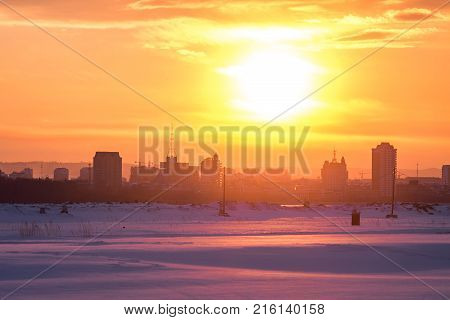 Bright winter sunset over chinese town Heihe with fields of snow on the border between China and Russia Blagoveschensk
