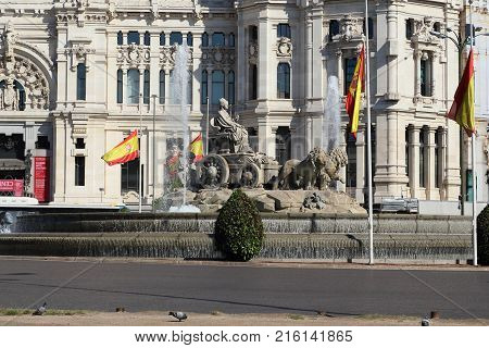 MADRID, SPAIN - MAY 24, 2017: This is the famous Cibeles Fountain which represents the goddess of nature on a chariot drawn by lions.