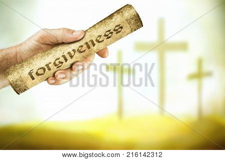 A hand that shows the message of forgiveness from the cross of the Lord Jesus.