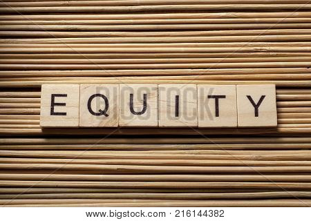 EQUITY word written on wooden cubes. Finance concept