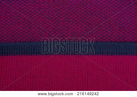 red fabric texture with black stripe on clothes