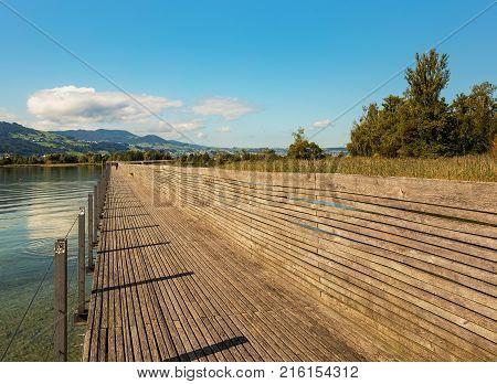 The Rapperswil-Hurden bridge in Switzerland. The Rapperswil-Hurden bridge is a wooden pedestrian bridge between the city of Rapperswil and the village of Hurden over the Lake Zurich it is the longest wooden bridge in Switzerland.