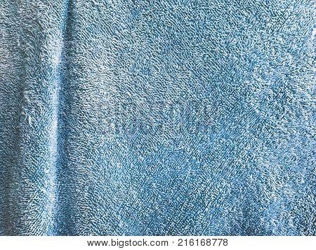 Blue furrow towel background. Deep detail texture