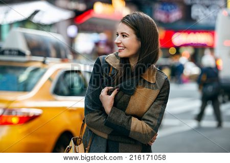 Happy woman enjoy the walk on winter time on New York City street and doing Chrismas shooping