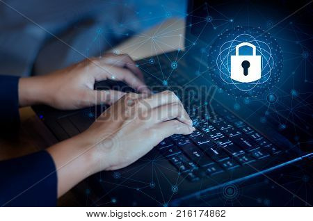 Press enter button on the computer. Key lock security system abstract technology world digital link cyber security on hi tech Dark blue background, Enter password to log in. lock finger Keyboard