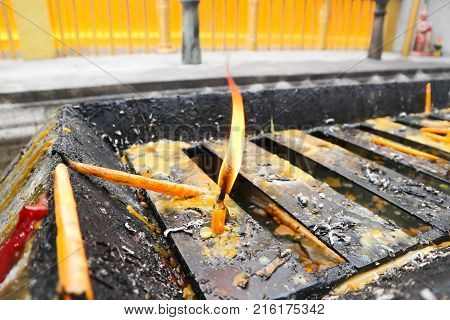 wax taper or the candle in the temple