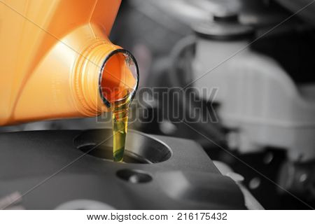 Close up Pouring motor oil to car engine.