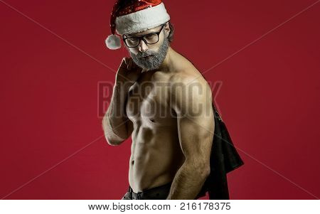 Tough santa claus with red bag. Copy space