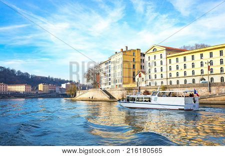 Lyon France - December 9 2016: The architectures of the old town seen from the Saone river with a boat for tourists