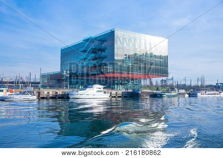 Lyon France - December 9 2016: Confluence district the Crystal Palace building on the Saone river bank