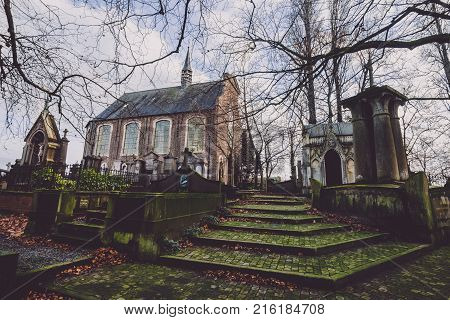 January, 4th, 2017 - Ghent, East Flanders, Belgium. Saint Amandus chapel on Campo Santo historical cemetery in Sint-amandsberg municipality, Gent. Roman church, ancient tombs, graves and monuments.