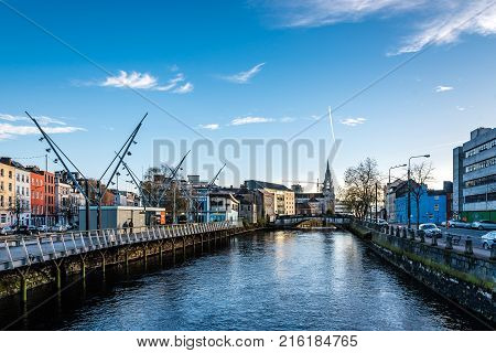 Cork, Ireland - November 12, 2017: Riverside of Cork a blue sky day with clouds