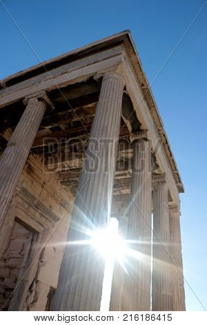 Parthenon temple on the Acropolis of Athens with lights go through, Greece.