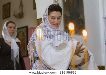 Belarus the city of Gomel St. Nicholas Monastery.July 23 2017.Baptism of the Child.Child in the arms of the mother.Baptism of the baby. Accept the faith. Newborn in the church.