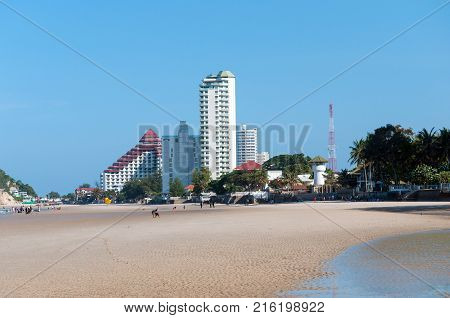 Beautiful seascape with a mountain Khao Takiab with a 20-meter Buddha statue and several temples, beach and condominiums. Hua Hin, Thailand