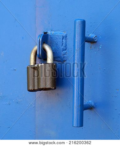 Locked padlock with at door metal old protect rusty