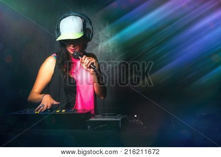 Close-up Of Female Hands On A Deejay Console With Microphone