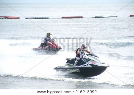 CHONBURI ,THAILAND - DECEMBER 6,2015 : Unidentified riders from all over the World in jet Ski racing came to King's Cup jet Ski World Cup 2015 Competition at Jomtien beach, Pattaya in Chonburi Province , Middle of Thailand.