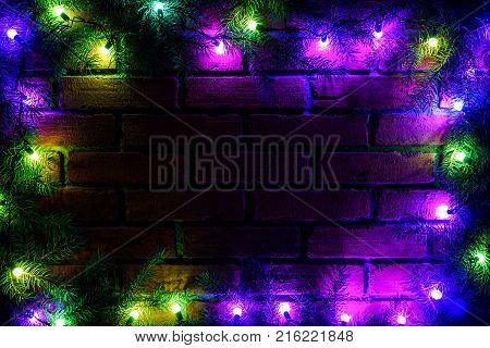 Wreath And Garlands Of Colored Light Bulbs.christmas Background With Lights And Free Text Space. Chr