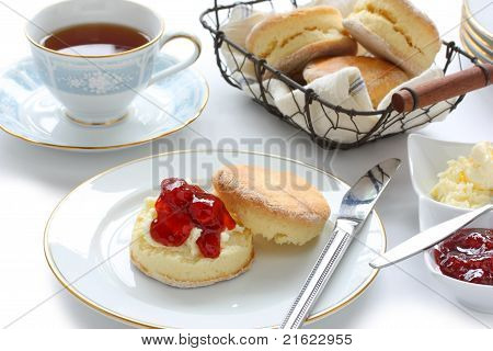 scone with strawberry jam and clotted cream , cream tea , devonshire tea , tea party , afternoon tea