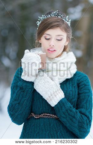 Beautiful woman holding hot cocoa glass cup with marshmallows dessert