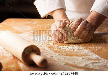 Hands hand woman dough knead table white