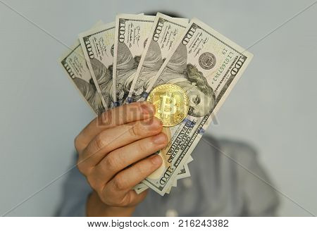 Bitcoin Golden Coins On A Dollar Banknotes.