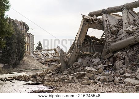 Collapsed industrial building made of concrete with ruins