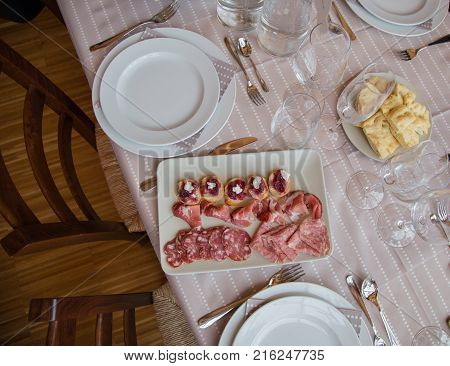 top view of typical pasta from the Piedmont region of Italy with cured meats