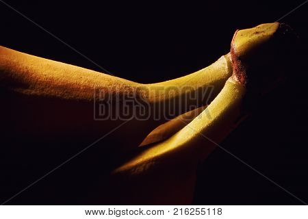 Studio shot of fresh banana accentuated shapes with illumination.