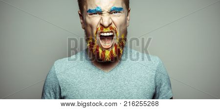 Portrait Of A Cry Man With A beard Unraveled In Red And Yellow Colors . Referendum For The Separation Of Catalonia From Spain. Democracy Independence Concept