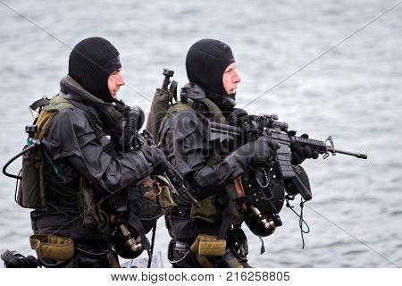 DEN HELDER THE NETHERLANDS - JUN 23 2013: Special Forces combat diver during an amphibious assault demo at the Dutch Navy Days.