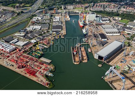 ROTTERDAM THE NETHERLANDS - SEP 2 2017: Aerial view of various shipping and industrial companies in the Port of Rotterdam.