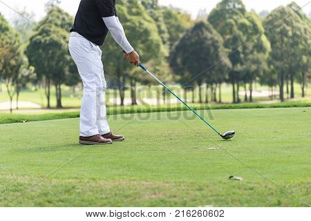 Asian golfers hit sweeping and keep golf course in the summer for relax timesoft focus and blurryGOLF BALL ON T-OFF