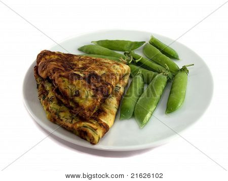 Omelet with peas on a plate