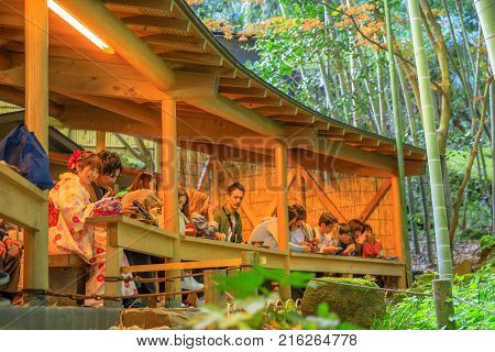 Kamakura, Japan - April 23, 2017: Japanese people in kimono and tourists at green tea in Hokoku-ji Take-dera Buddhist temple with bamboo forest.The Tea Ceremony is a popular cultural activity in Japan