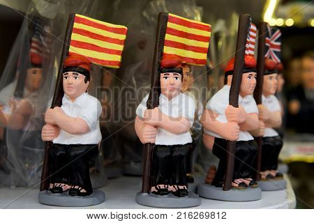 some caganer, a typical catalan character in the nativity scenes of catalonia, spain, depicting a catalan peasant defecating, on sale in a stall of a christmas market