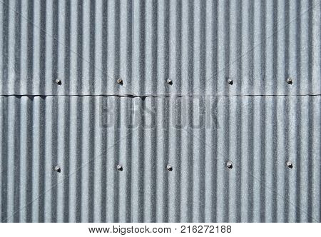 Old galvanized sheet texture background vertical with screws