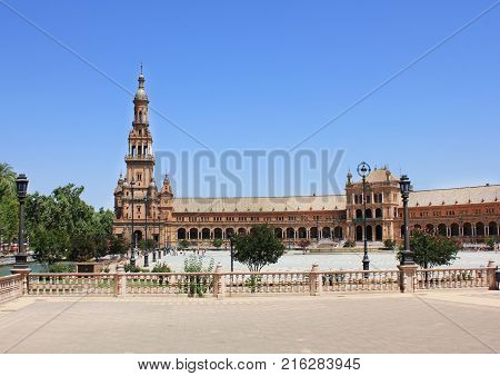 Plaza de Espana in Seville City, Spain. Spain Square is a Semi Circular Brick Building Built in Renaissance and Neo-Moorish Architecture Style with Beautiful Ceramic Tiles Ornaments and Lanterns.