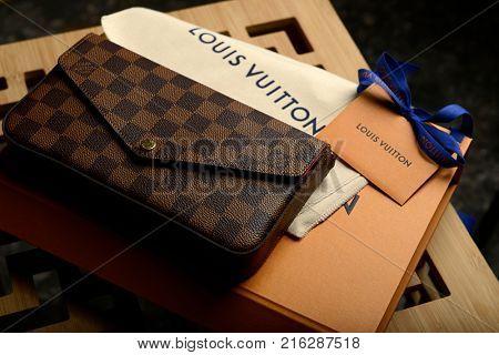 Istanbul, Turkey - October 07, 2017: French fashion designer Louis Vuitton brown woman hand bag.