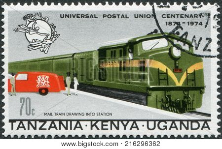 EAST AFRICAN COMMUNITY - CIRCA 1974: A stamp printed in East African Community, is dedicated to the 100th anniversary of the Universal Postal Union, shows a mail train and postal car, circa 1974
