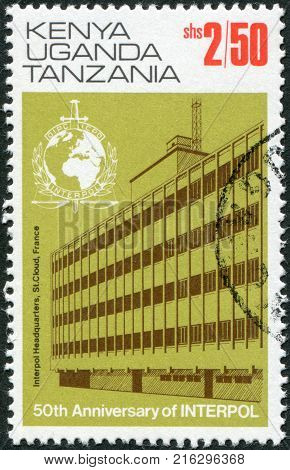 EAST AFRICAN COMMUNITY - CIRCA 1973: A stamp printed in East African Community, is dedicated to the 50th anniversary of Interpol, shows the headquarters building in Saint-Cloud (1966-1989), circa 1973