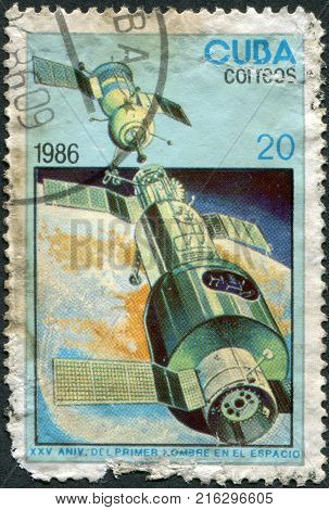 CUBA - CIRCA 1986: Postage stamps printed in Cuba, dedicated to the 25th anniversary of manned flight into space, shows orbital complex, Salyut-Soyuz, circa 1986