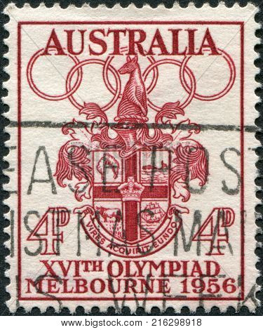 AUSTRALIA - CIRCA 1956: A stamp printed in Australia, shows Melbourne Coat of Arms and the Olympic rings, circa 1956