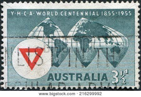 AUSTRALIA - CIRCA 1955: A stamp printed in Australia, shows the World Map, YMCA Emblem, circa 1955