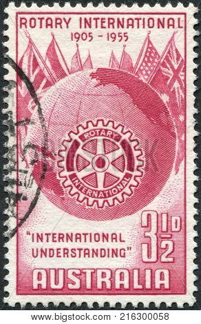 AUSTRALIA - CIRCA 1955: A stamp printed in Australia, is dedicated to the 50th anniversary of Rotary International, shows the Globe, Flags and Rotary Emblem, circa 1955